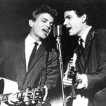 In this July 31, 1964, file photo The Everly Brothers, Phil, left, and Don, perform on stage. Graham Nash, Vince Gill and Emmylou Harris are among the performers set to pay tribute to the Everly Brothers in October 2014. The Rock and Roll of Fame announced Wednesday, Sept. 3, 2014, that Peter Asher, Shelby Lynne and the Secret Sisters will also perform at the Oct. 25 event at PlayhouseSquare's State Theatre in Cleveland. Phil Everly died from chronic obstructive pulmonary disease earlier this year. Surviving member Don Everly will attend.