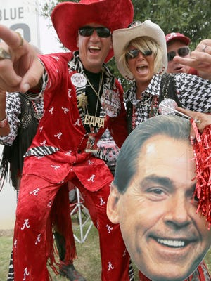 Alabama fans get into the spirit while tailgating before a recent Crimson Tide game.