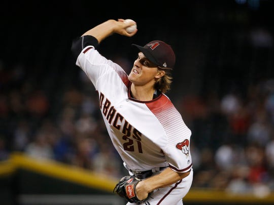 Arizona Diamondbacks starting pitcher Zack Greinke throws to a Los Angeles Dodgers batter during the first inning of a baseball game Wednesday, Sept. 26, 2018, in Phoenix. (AP Photo/Ross D. Franklin)