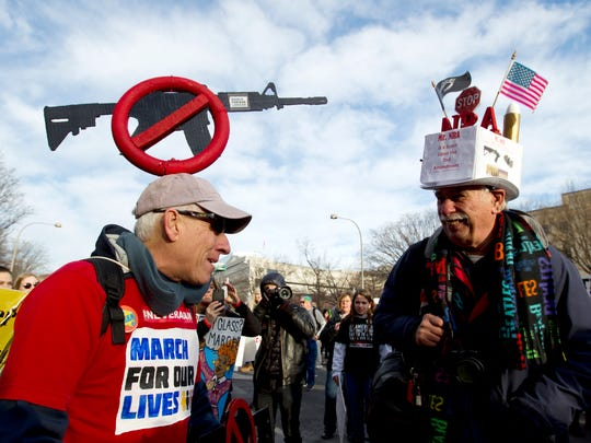 "Steven Rothman, left, and Dan Knorowski attend the ""March for Our Lives"" rally in support of gun control in Washington, Saturday, March 24, 2018. (AP Photo/Jose Luis Magana)"
