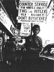Civil rights activists picket outside Katz Drug Store in downtown Des Moines, where in 1948 Edna Griffin was refused service at the lunch counter because she was black.
