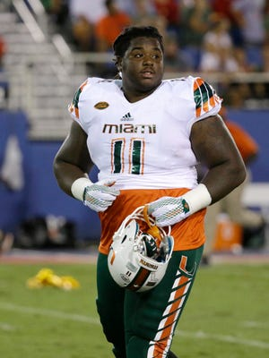 Miami defensive lineman Michael Wyche walks off the field at the end of the first half of an NCAA college football game against Florida Atlantic, Friday, Sept. 11.