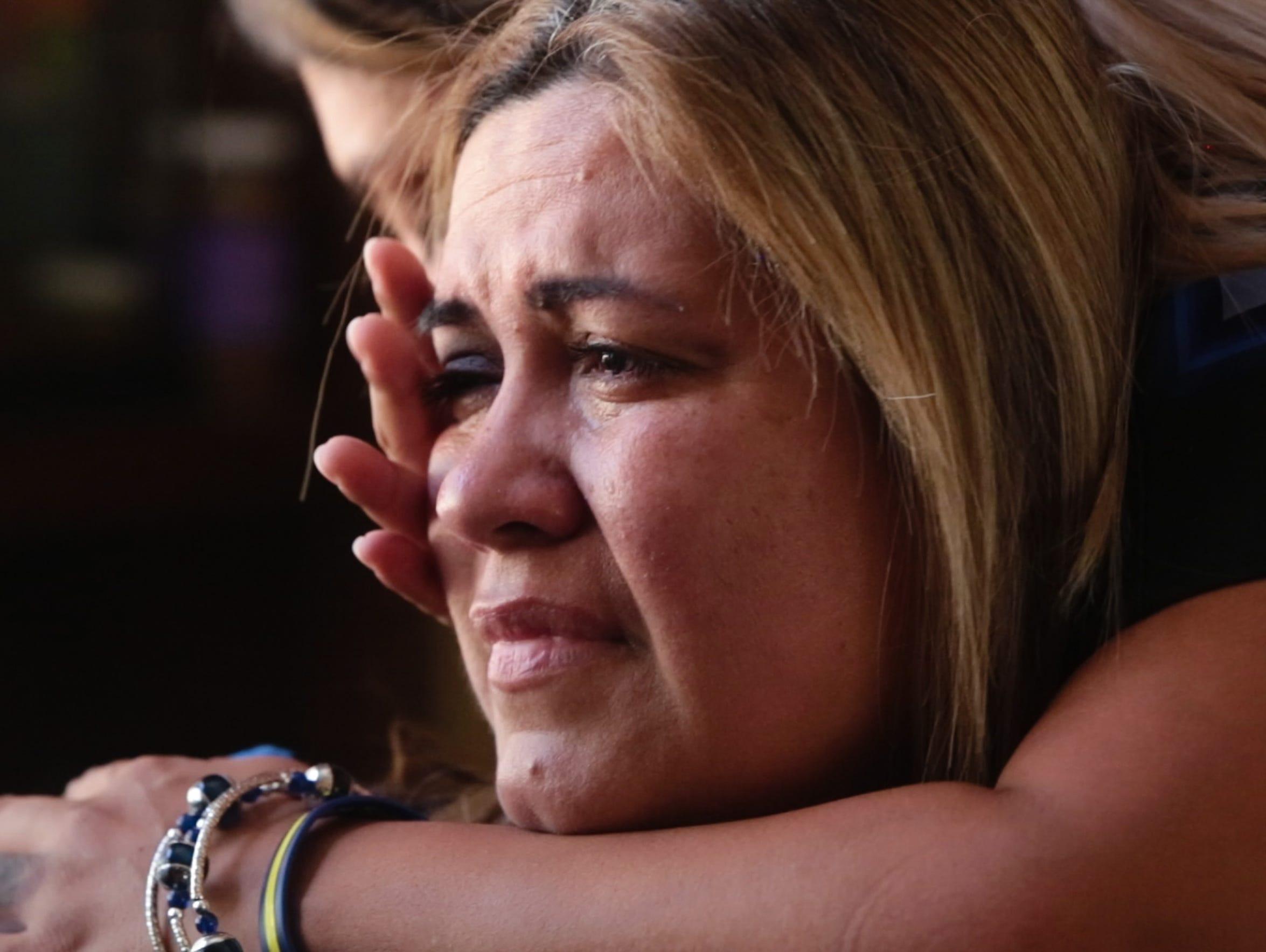 Yvette Clark is embraced by her sister Gloria Vega