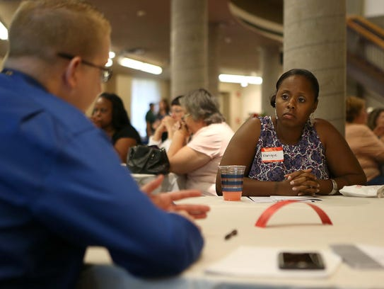 Veteran Monique Walker talks with a Veterans Affairs