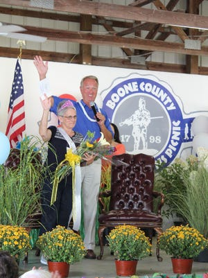 Judge-executive Gary Moore waves to the crowd alongside Donna Paul, of Florence, who was crowned Queen of the Boone County senior picnic on Sept. 14 at the Boone County Fairgrounds.