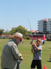 Children participate in the annual free fishing clinic