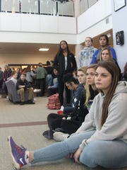 Some 800 Lakeview High School students held a memorial service for the Parkland 17 in their school's library.