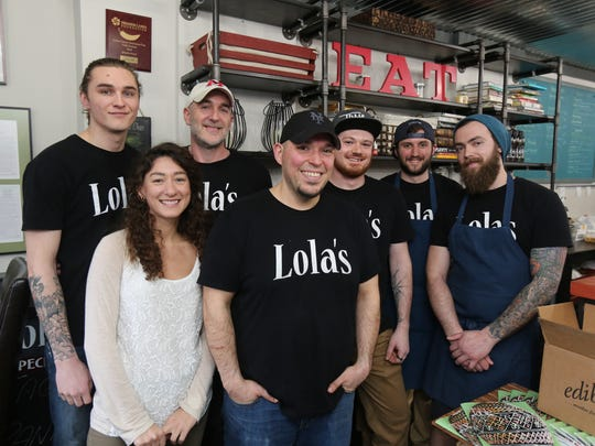 Chef/owner Ed Kowalski, third from left, pose with his kitchen crew at Lola's Cafe and Catering on Washington Street in Poughkeepsie, April 4, 2017.