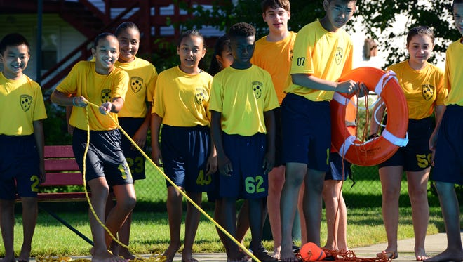 Students learn about water rescue at the Bogota Swim Club during the Bogota Police Youth Academy. On Wednesdsay they trained with SCUBA instructors, learned about water rescue, and took apart cars with the jaws of life tools from the Bogota Rescue Squad.