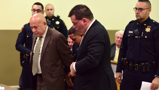 """Joseph """"Joey"""" Torres is handcuffed after he was sentenced to five years of prison time for his role in a corruption scandal during his time a Paterson mayor before Hudson County Superior Court Judge Sheila Ann Venable Tuesday morning."""