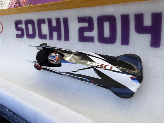 The USA-3, men's two man bobsled team from the United States, take a turn during a training run at the 2014 Winter Olympics, Feb. 5, 2014, in Krasnaya Polyana, Russia.