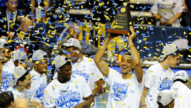 Kentucky players celebrate  after winning the SEC Conference title over Arkansas on Sunday.
