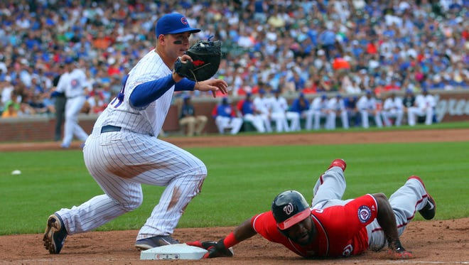 Washington Nationals center fielder Denard Span (2) is picked off first base with Chicago Cubs first baseman Anthony Rizzo (44) applying the tag during the sixth inning at Wrigley Field.