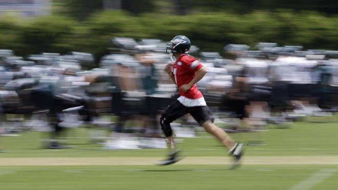 In this image taken with a slow shutter speed, Sam Bradford exercises on his own before organized team activities at the team's practice facility May 28 in Philadelphia.