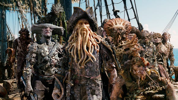 Davy Jones (Bill Nighy, center) captains the monstrous