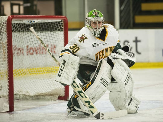 Vermont goalie Madison Litchfield (30) keeps an eye on the puck during a women's hockey game between the UConn Huskies and the Vermont Catamounts at Gutterson Field House on Friday night January 29, 2016 in Burlington. (BRIAN JENKINS/for the FREE PRESS)