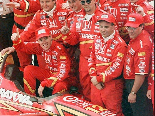 Pole sitter Jimmy Vasser celebrates with his team after winning the U.S. 500 in Brooklyn, Mich., May 26, 1996.