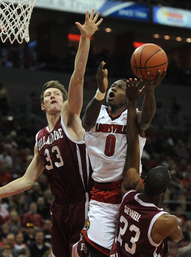 UoL's Terry Rozier (0) shoots against Bellarmine on