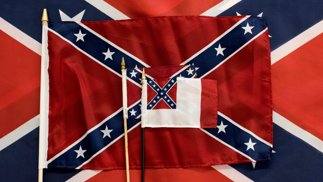 HUNTSVILLE, ALABAMA - APRIL 12: Different sizes of Confederate flags are displayed during the manufacturing process at the Alabama Flag and Banner on April 12, 2016 in Huntsville, Alabama. The company, which sells American flags and manufactures Confederate flags, sold around 20,000 flags last year and about 12,000 of those were confederate flags. (Photo by Ty Wright/Getty Images)