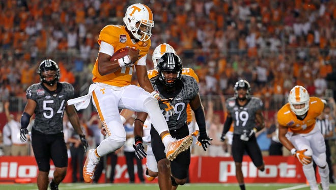 Tennessee Volunteers quarterback Joshua Dobbs (11) scores a touchdown against the Virginia Tech Hokies during the second quarter at Bristol Motor Speedway.