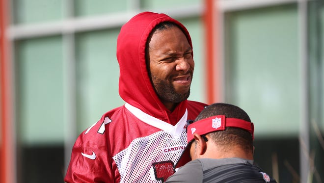 Arizona Cardinals wide receiver Larry Fitzgerald gets taped-up during OTAs on Tuesday, May 16, 2017 at the Arizona Cardinals Training Facility in Tempe, Ariz.