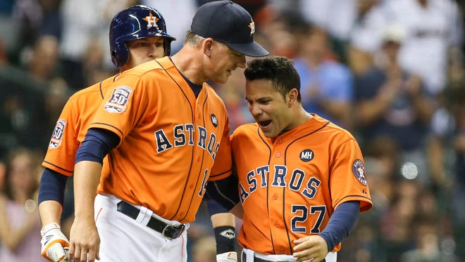 """""""We know nothing bad can happen,"""" says Astros manager A.J. Hinch, here with Jose Altuve, """"if we continue to win."""""""