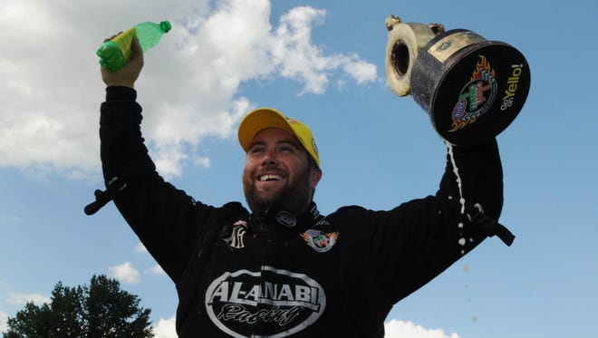 FILE -- Shawn Langdon celebrates winning the US Nationals Top Fuel Finals, Sept. 2, 2013  at Lucas Oil Raceway.