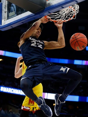 Xavier Musketeers forward Kaiser Gates (22) dunks against Maryland Terrapins guard Kevin Huerter (4) during the second half in the first round of the NCAA Tournament at Amway Center.
