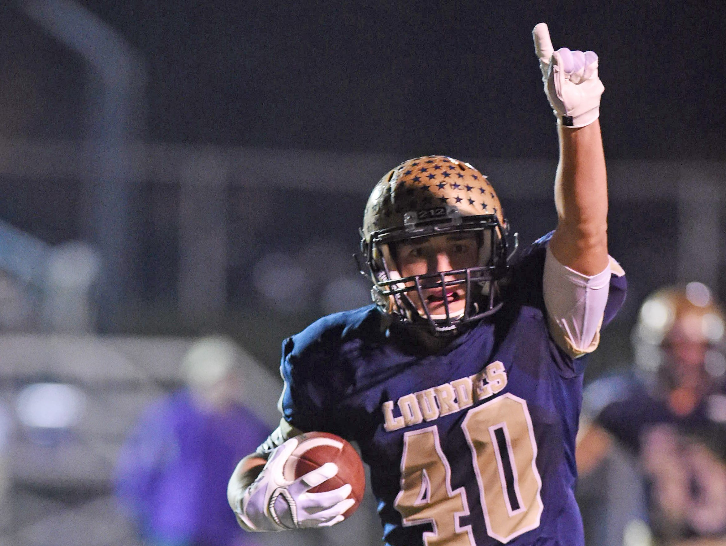 Our Lady of Lourdes High School's Billy Wagner celebrates a touchdown during his team's state Class A semifinal victory over Amsterdam at Dietz Stadium in Kingston on Nov. 20.