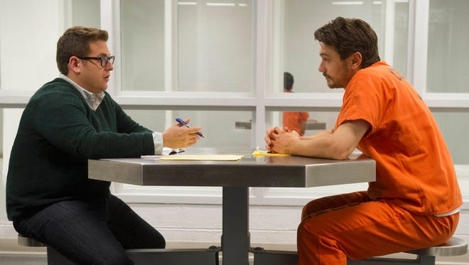 "Jonah Hill, left, is a disgraced reporter covering an accused murderer who took his name (James Franco) in ""True Story."""