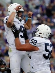 Penn State offensive lineman Ryan Bates, right, celebrates a touchdown last season by lifting up quarterback Trace McSorley. Bates and McSorley will both return this season for the Nittany Lions. AP FILE PHOTO