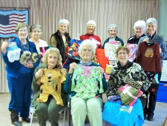 Woman's Club members with pajamas the NEST