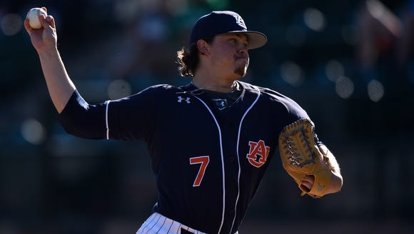 Auburn pitcher Keegan Thompson (7). allowed just one