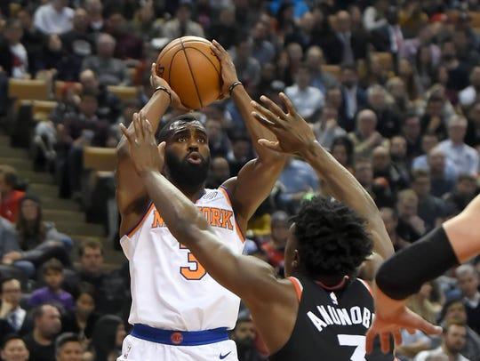 New York Knicks guard Tim Hardaway Jr. (3) looks to
