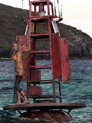 "Nancy (Blake Lively) plans her next move in ""The Shallows."""