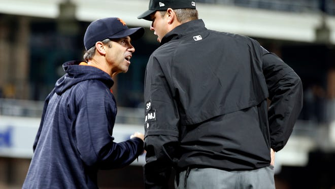 Tigers manager Brad Ausmus, left, argues with first base umpire Jordan Baker, who called Ian Kinsler out on a swinging strike call during the eighth inning of the Tigers' 1-0 loss Friday in San Diego.