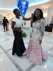 Students and their guest attend the Dickinson High School prom Saturday, April 28, 2018 at Waterfall Banquet Center in Claymont.