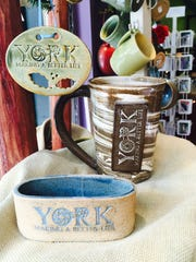 Clay Path Studios teamed up with area artist Carmen Walsh to create products with a distinct York logo.