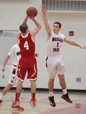 Thomas Dunbar, right, is one of three returning varsity players for the Wausau East boys basketball team this season.