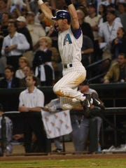 Diamondbacks' Luis Gonzalez jumps up after his game-winning hit in the ninth inning against the Yankees in Game 7 of the 2001 World Series