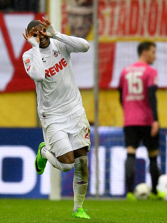 Cologne's Anthony Modeste celebrates after he scored his third goal during the German Bundesliga soccer match between 1.FC Cologne and Hertha BSC Berlin in Cologne, Germany, Saturday, March 18, 2017. (AP Photo/Martin Meissner)