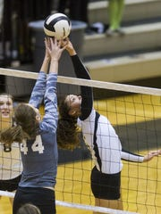 Avon's Darian Goins (5) leads the Orioles into the