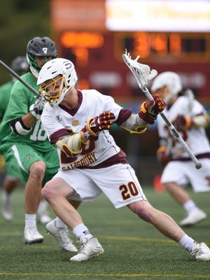 Salisbury's Mike Kane protects the ball as he works against York's defense. The Sea Gulls defeated York 16-4 on Saturday.