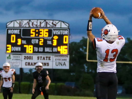 MTCS' Jackson Green leaps to make a catch that set