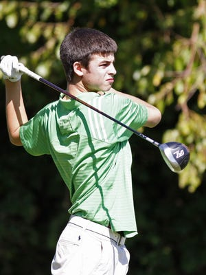 Mason High School's Alexander Ebel tees off on the tenth hole during the boys' Division I sectional golf tournament played at Glenview Golf Course in October of 2011.