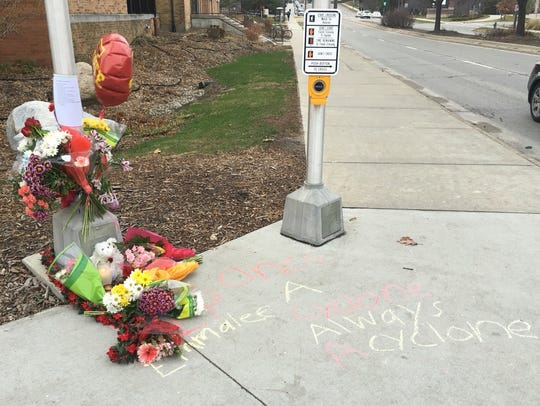 A memorial for Emmalee Jacobs marks the intersection