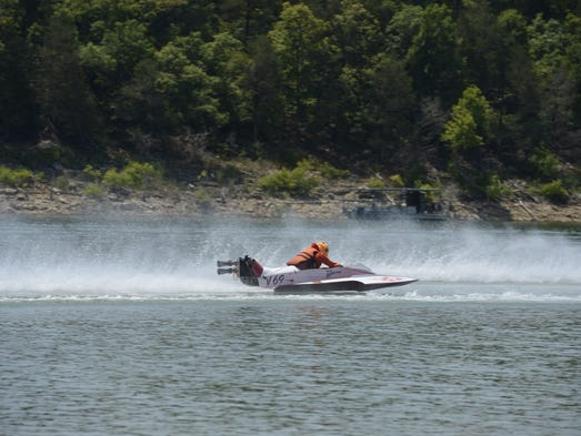 A racer competes during the 2013 Buzz on Pigeon Creek.