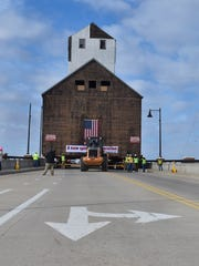 Lamps on the south side of the Maple-Oregon Bridge were removed when the granary was moved to the east side of Sturgeon Bay on March 29, 2018