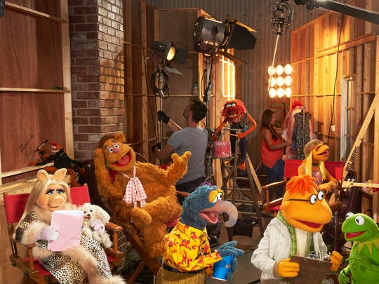 "From left Miss Piggy, Pepe The King Prawn, Fozzie Bear, Gonzo, Animal, background center, Scooter, Janice, Kermit the Frog and Floyd Pepper appear in a scene from ""The Muppets."""