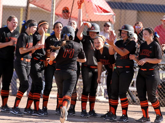 Paige Adair (17) is congratulated by teammates after
